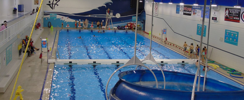 Community pool, with blue slide in foreground. (Credit: City of Brandon)