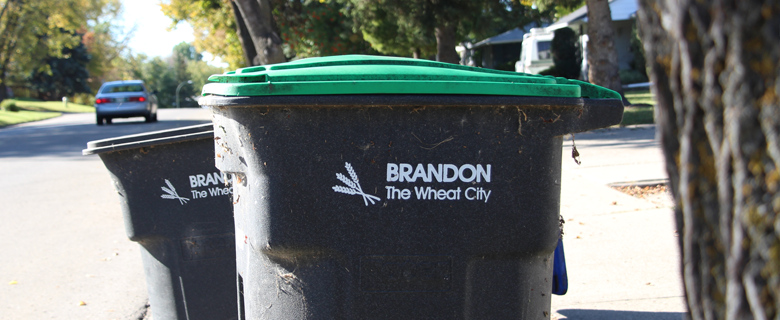 Black bin with green top on residential street. (Credit: City of Brandon)