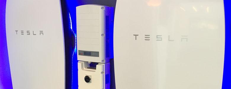 White Tesla rectangular battery with blue light. (Credit: City of Ajax)