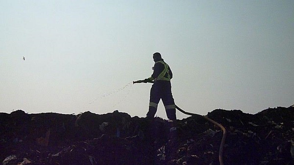 Worker on compost pad