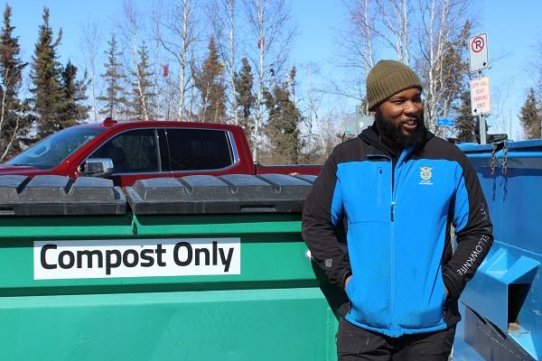 Chris Vaughn in front of compost bin