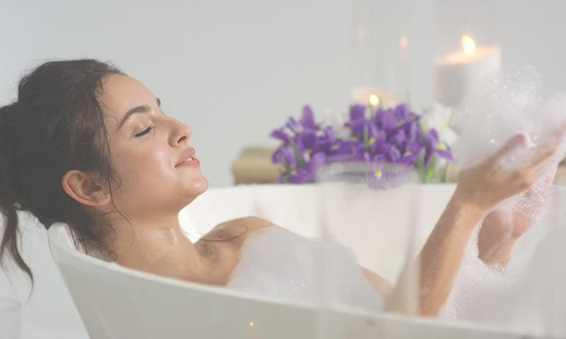 woman soaking in a bubble bath