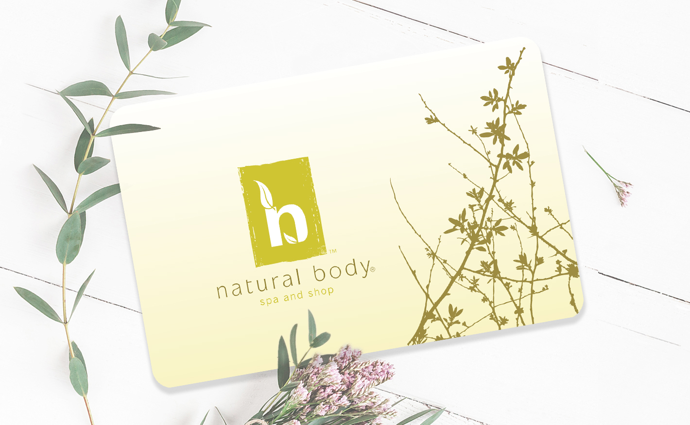 Natural Body gift card on background with eucalyptus