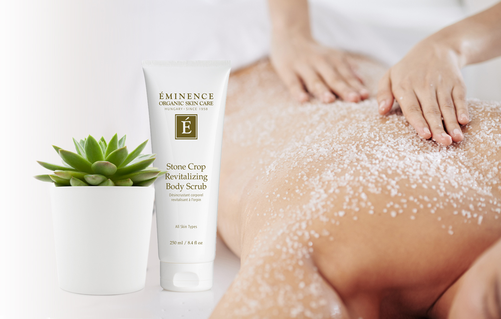 Woman receiving Seasonal Body Therapy treatment with Stone Crop Revitalizing Body Scrub.