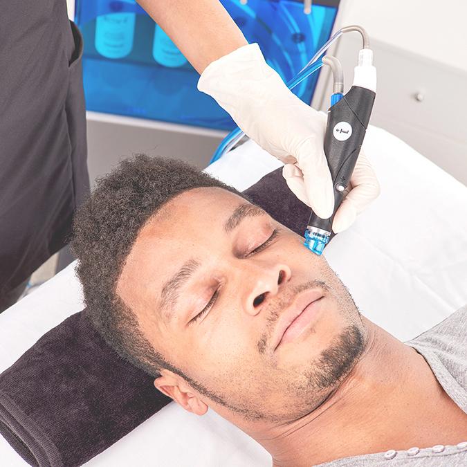 Male  receiving a HydraFacial treatment