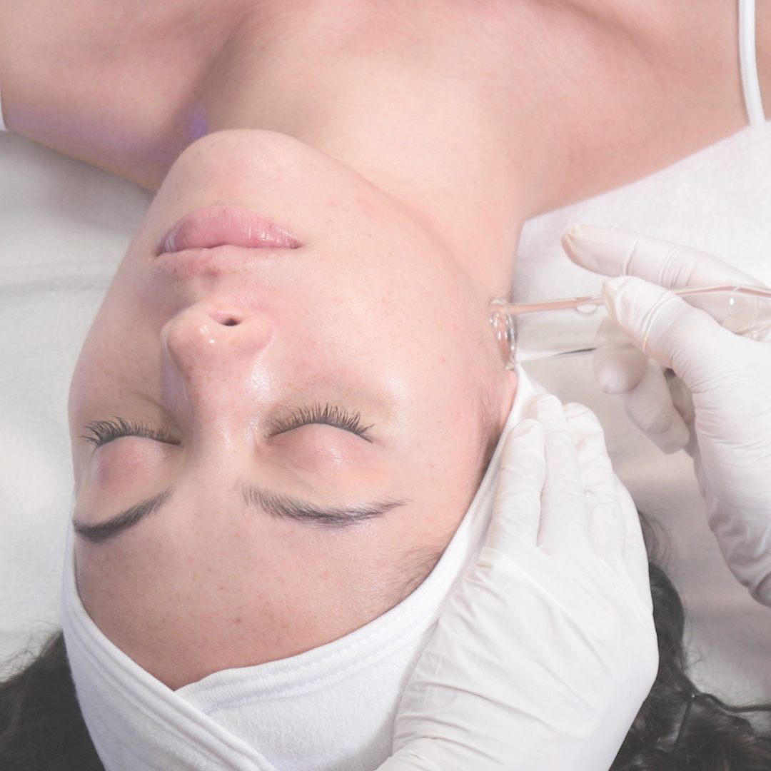 A woman having lymphatic drainage on her face.