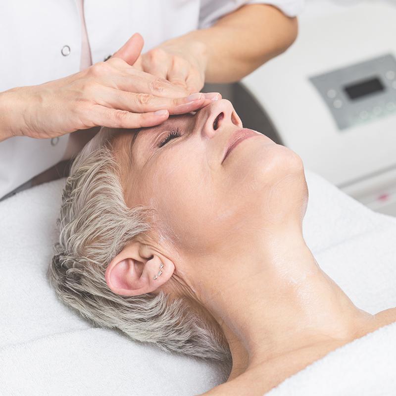 Mature woman receiving an advanced facial.