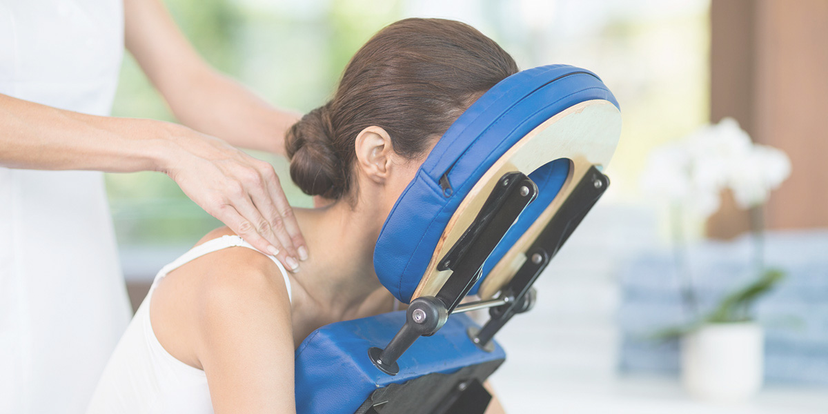 Woman receiving an onsite corporate chair massage.