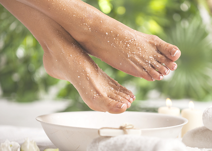 Woman with exfoliant on her feet.