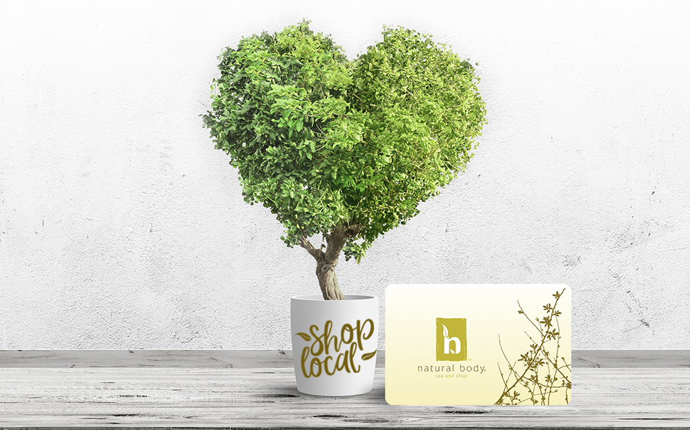 Natural Body gift card next to tree shaped as a heart with Shop Local icon.