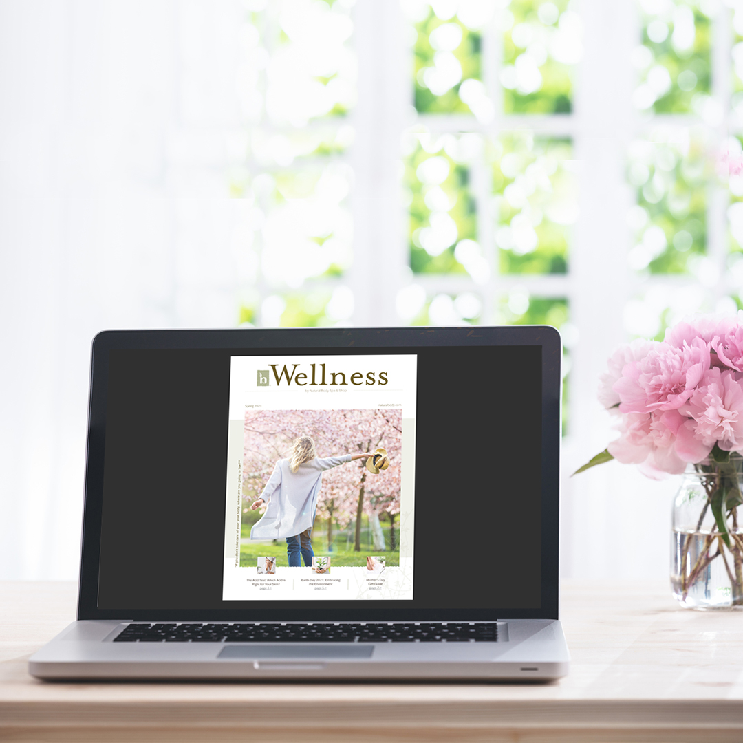 Natural Body Spring Wellness newsletter cover preview on a laptop next to peonies