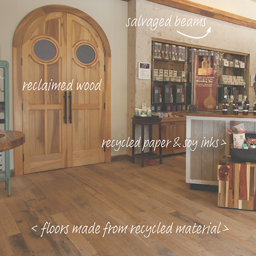Interior of Natural Body with captions demonstrating recycled materials including: reclaimed wood, salvaged beams and floors made of recycled materials
