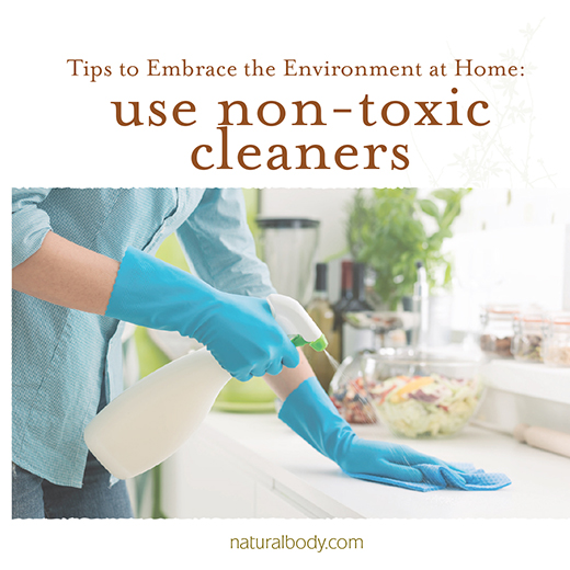 Woman spraying non-toxic cleaner on countertop