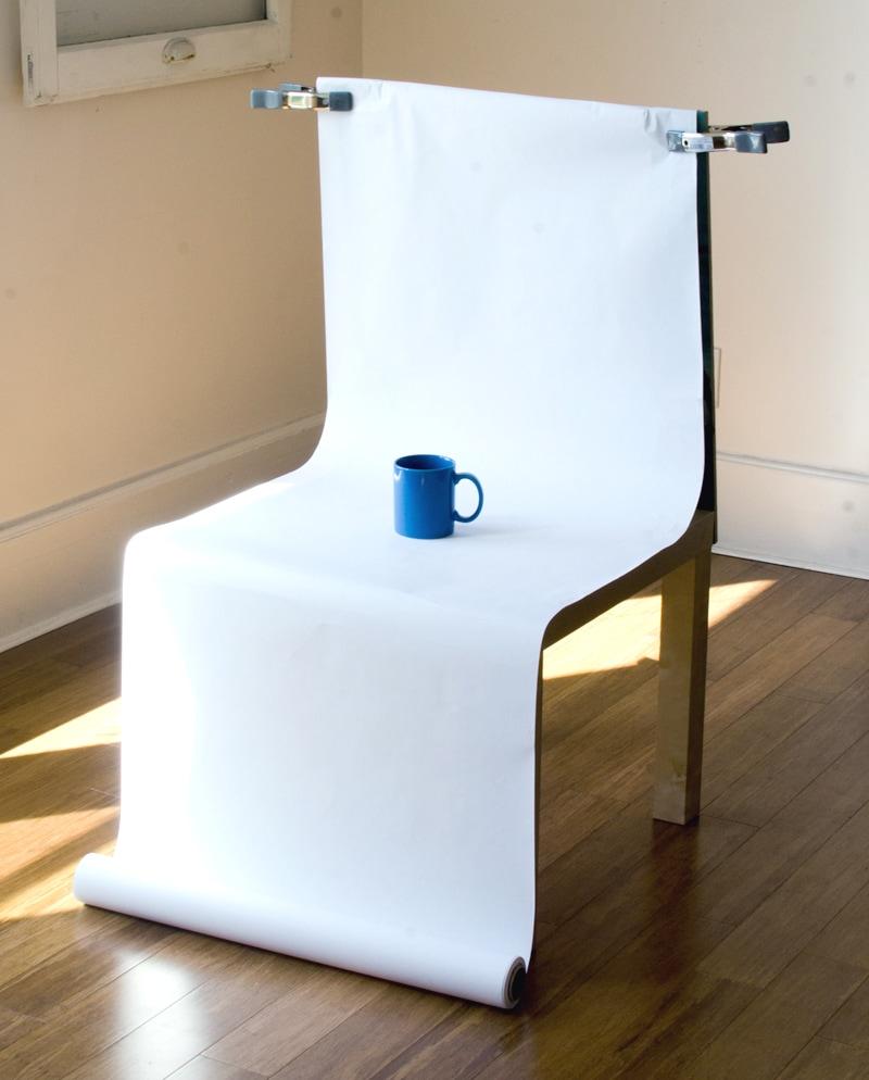 Blue coffee mug on chair with white sweep