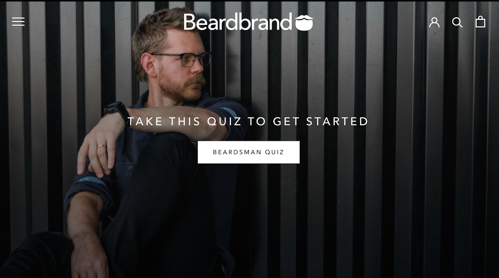 Beardbrand homepage with a bearded man in glasses in the background