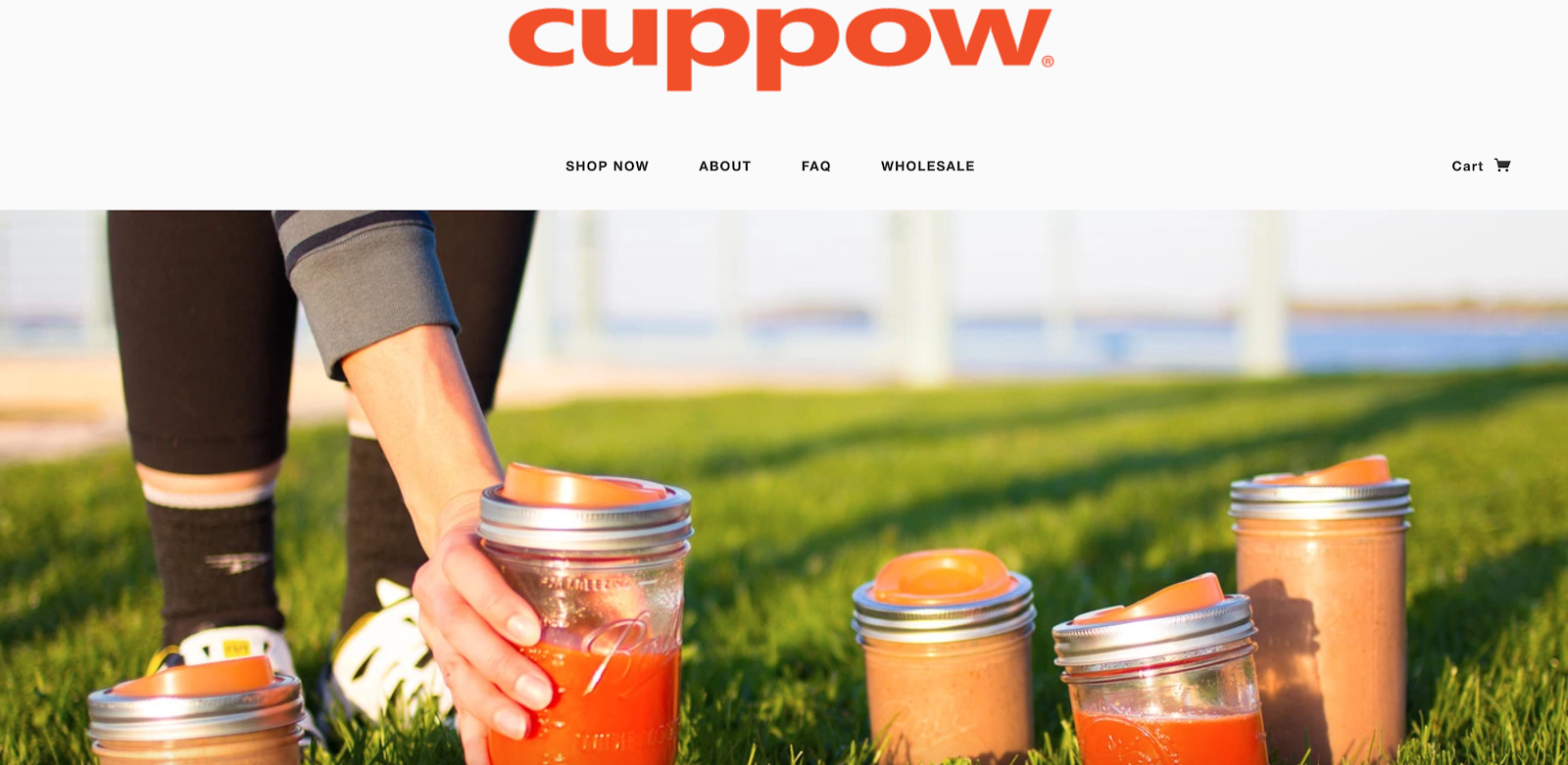 Cuppow homepage with Cuppow cups in the grass in the background