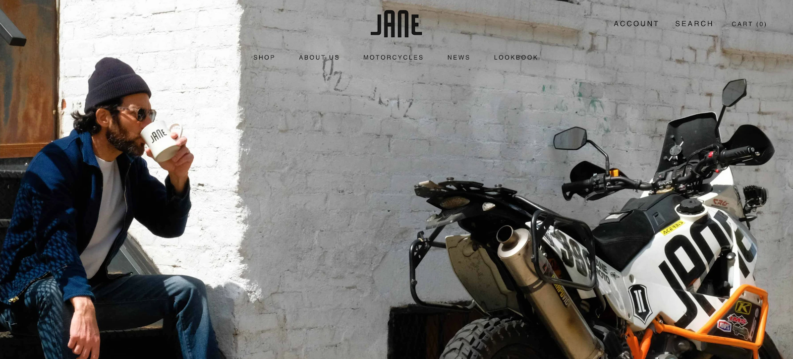 Jane Motorcycles homepage with man looking at motorcycle in the background