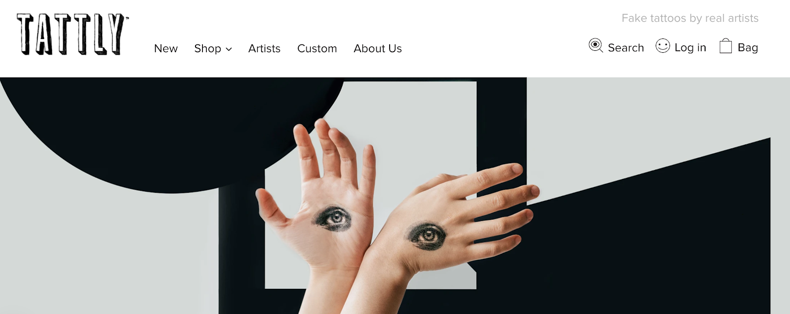Tattly homepage with hands with tattoos in the background