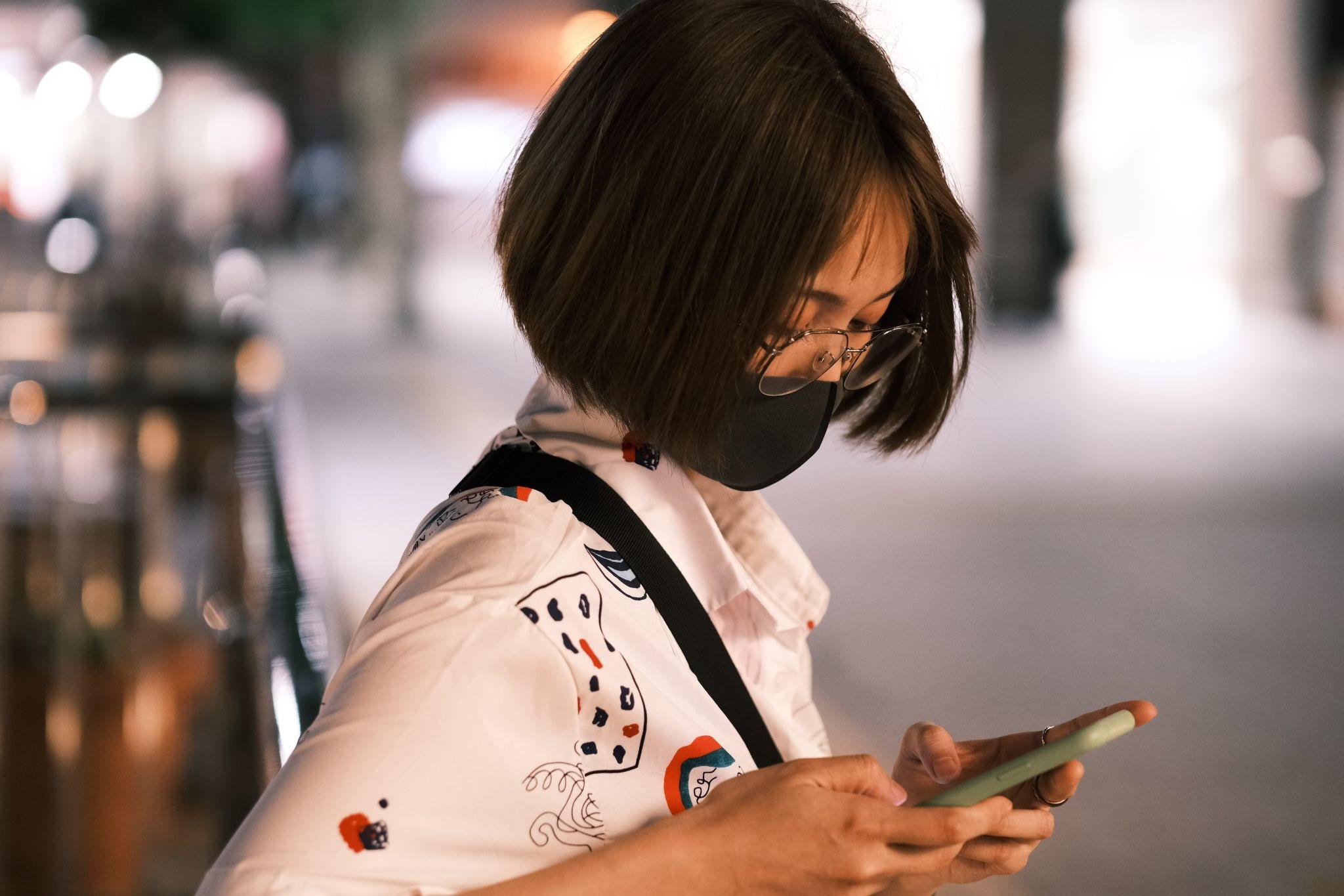 women using mobile phone sms marketing