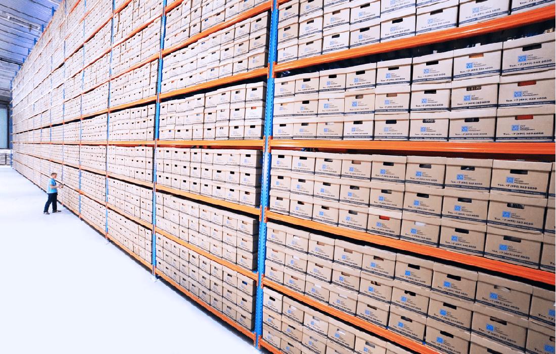 warehouse shelves boxes worker scanner