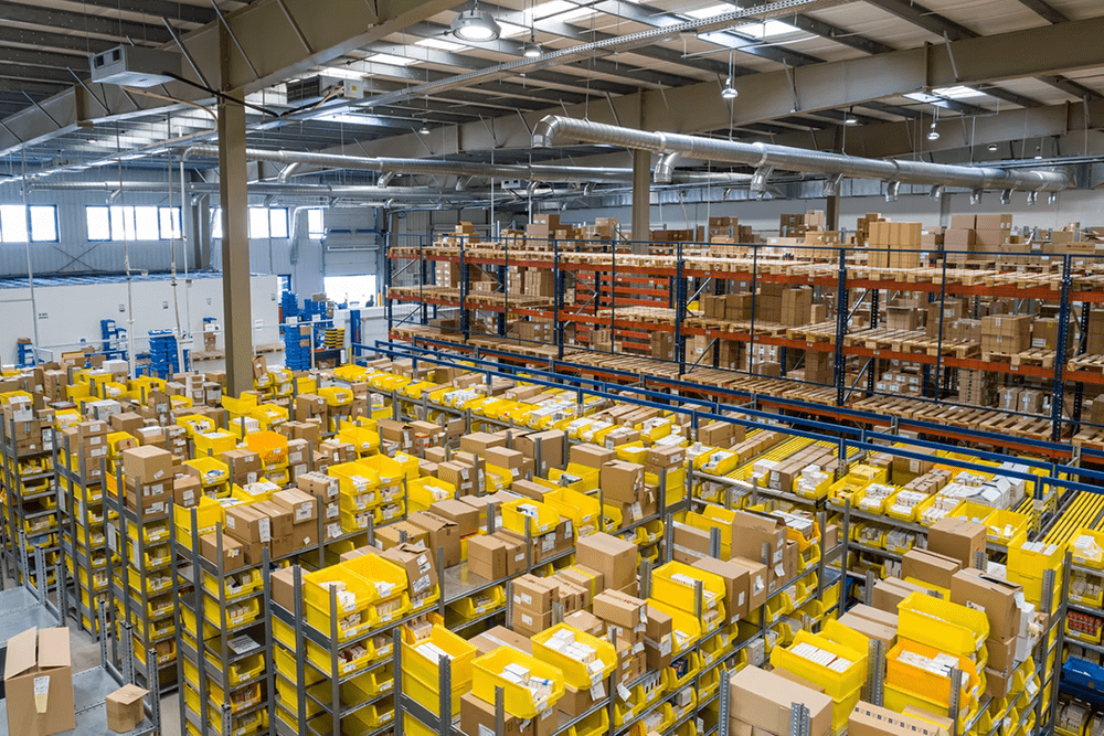warehouse from above shelves boxes packing