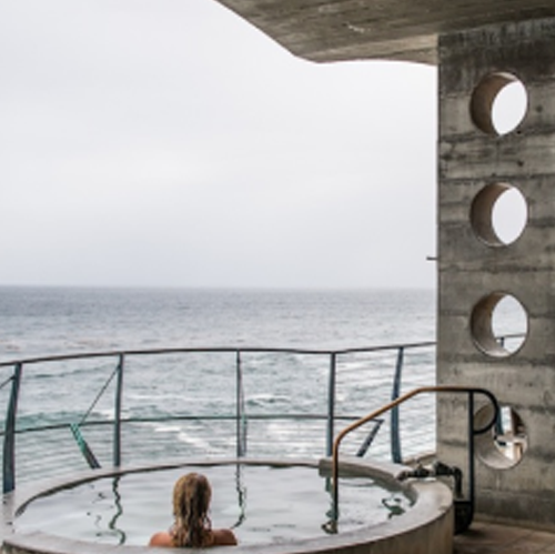 The Esalen Baths overlook the Pacific Ocean.