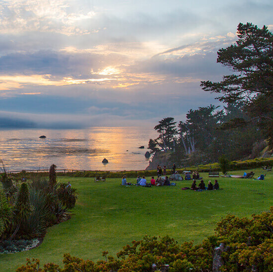 The lawn at Esalen is a popular spot to watch spectacular sunsets.