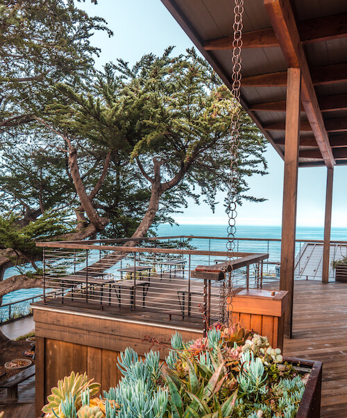 The deck outside Huxley, with the Pacific Ocean in the background.