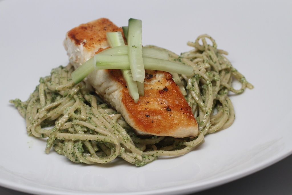 Long noodles covered in a light green sauce