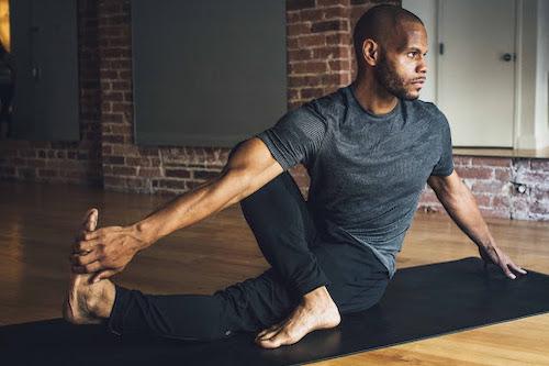Damien Alexander, yoga teacher in Marichyasana III (Sage's Pose)
