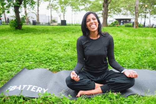 Tejal Patel, yoga teacher and co-host of Yoga is Dead podcast, practicing yoga in a park