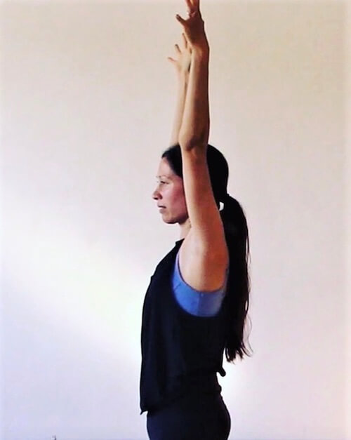 Monique Minahan, author and yoga teacher, demonstrating an empowering pose from her grief practice