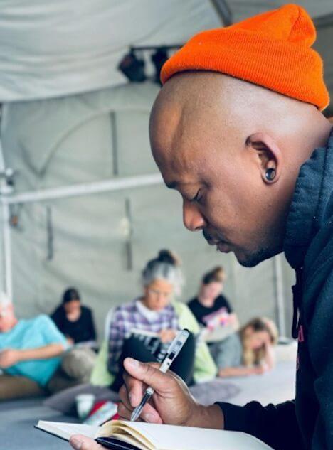 Darnell Walker leading Rituals Writing Workshop
