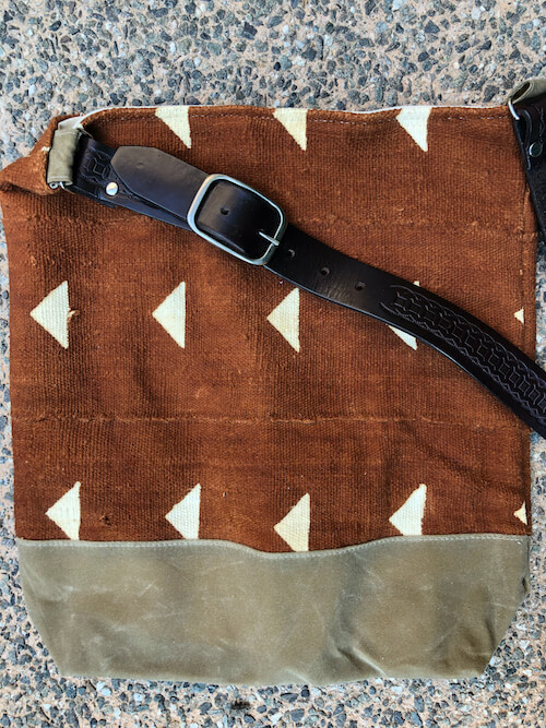 Close up of vintage belt strap and canvas bottom on Jenna Bee handmade African Mudcloth tote bags