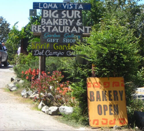 The sign for Big Sur Bakery & Restaurant among other businesses as you pass it on Highway 1 on the way to Esalen