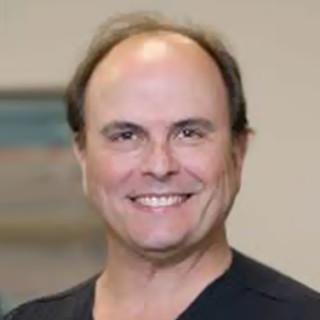 Dr. John Couvaras