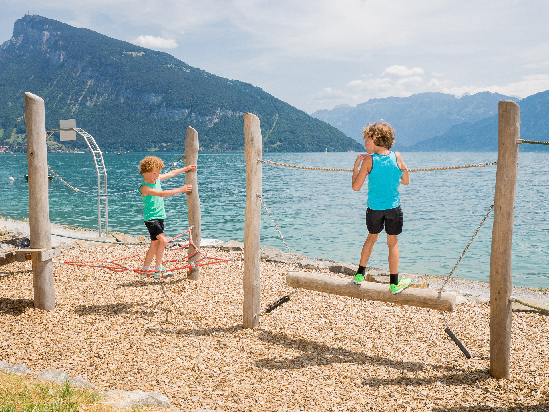 Children playing on the beach at Lake Thun