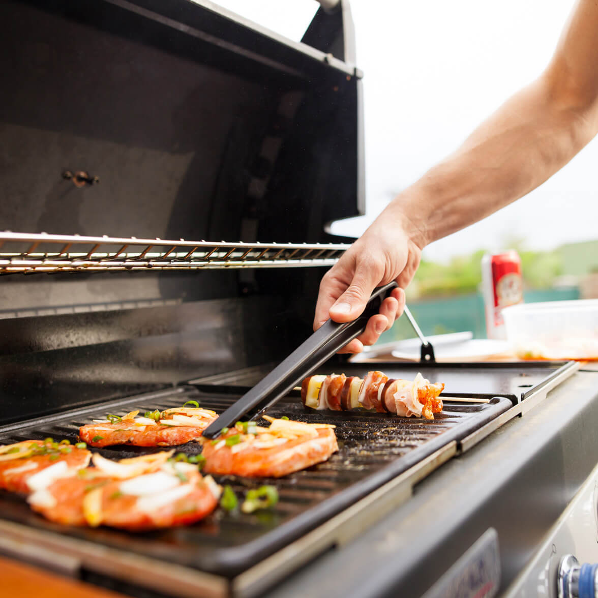 A person grilling food on a barbecue