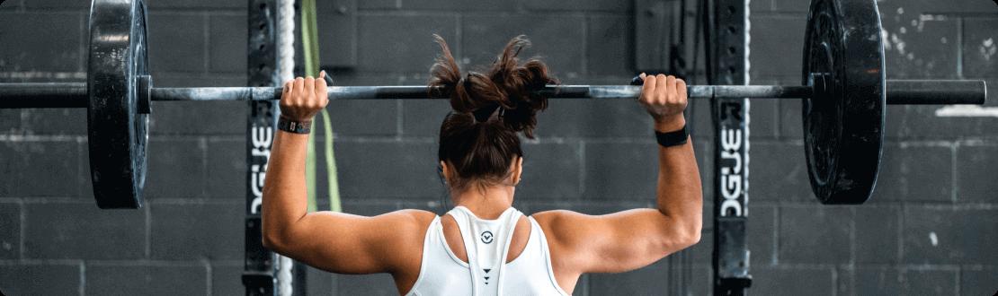 A Person Lifting weights PushPress Gym Management Software