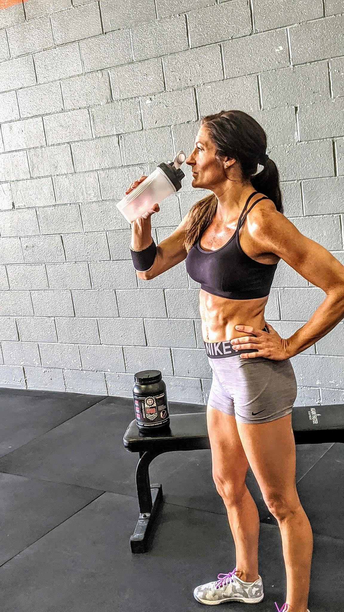 Gym member drinking protein shake