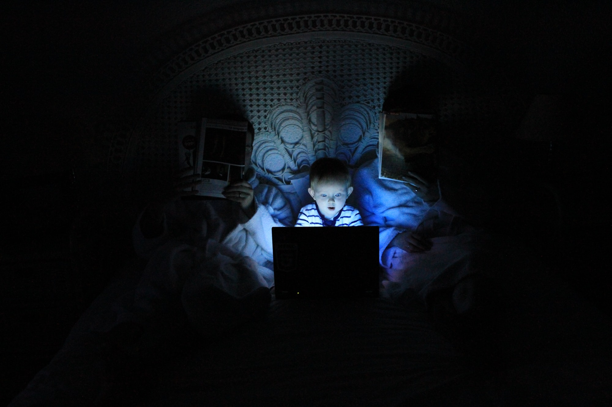 child in front of laptop