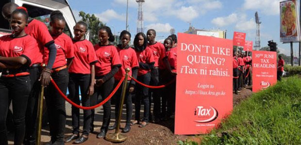 Models at a mock queue along Mombasa Road, Nairobi during the launch of a countrywide campaign by the Kenya Revenue Authority (KRA) to sensitise all taxpayers to adopt the online platform iTax to file returns in 2015.