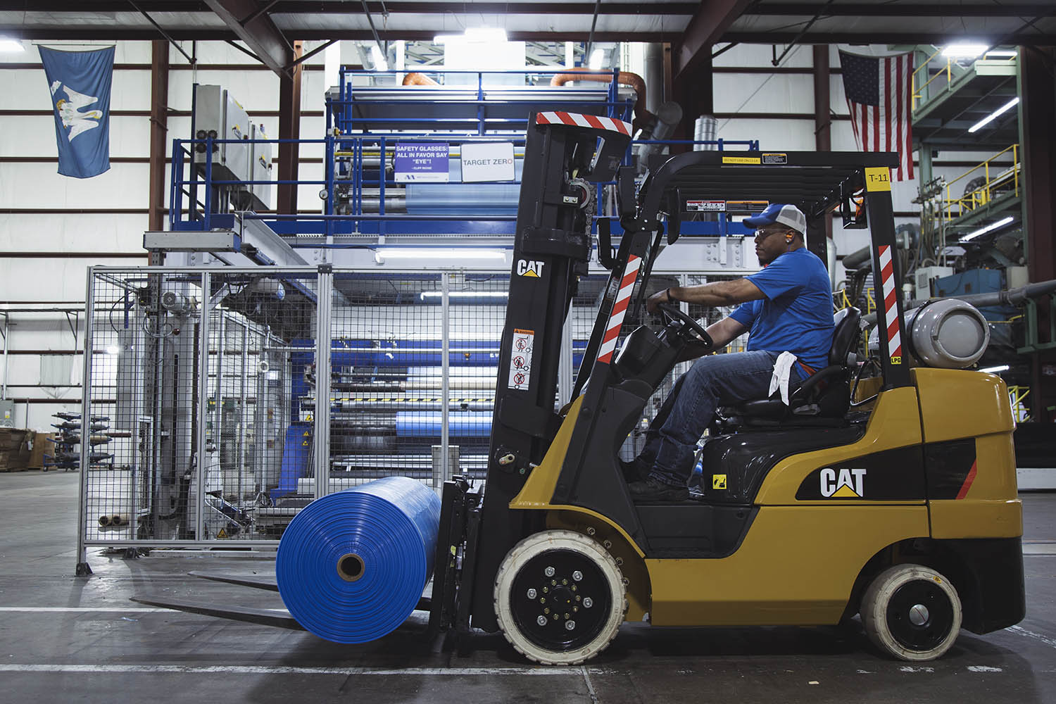 An MSE employee moving specialty film on a forklift