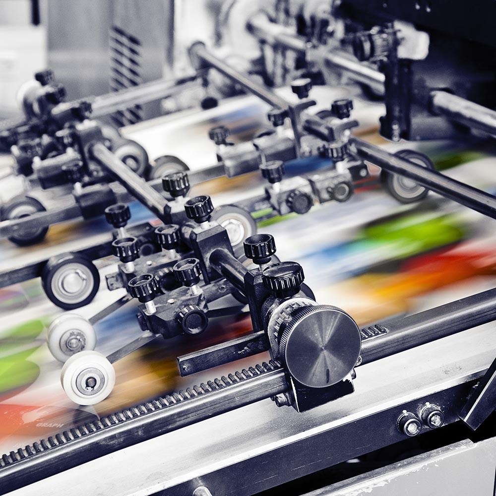 Printing press printing designs on custom film.
