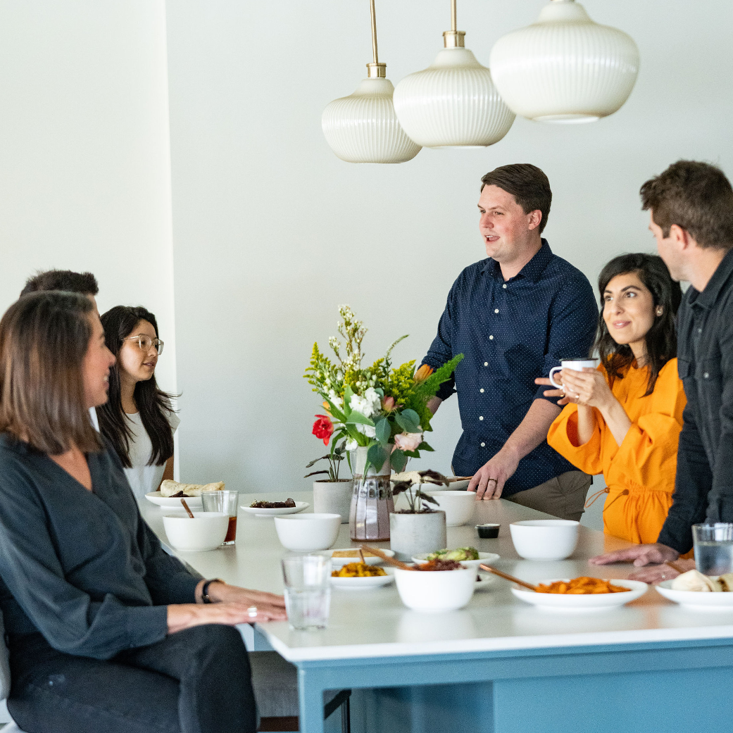 Local's team enjoys breakfast together in the office kitchen
