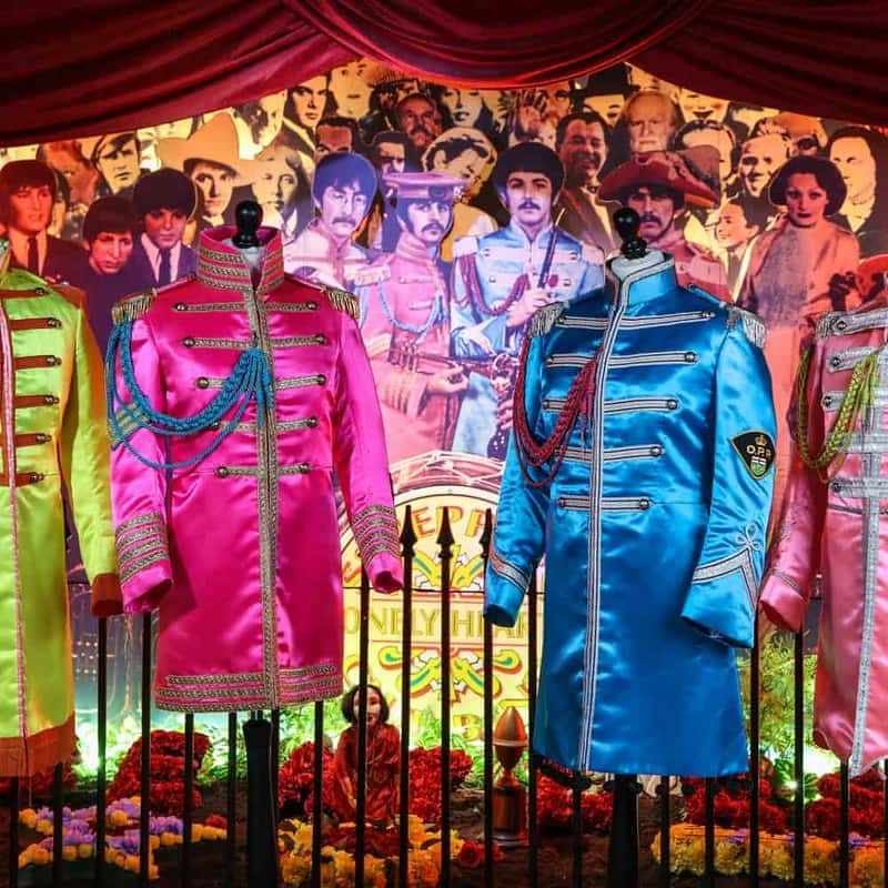 Costume exhibition at The Beatles Story museum with their famous brightly-coloured outfits.