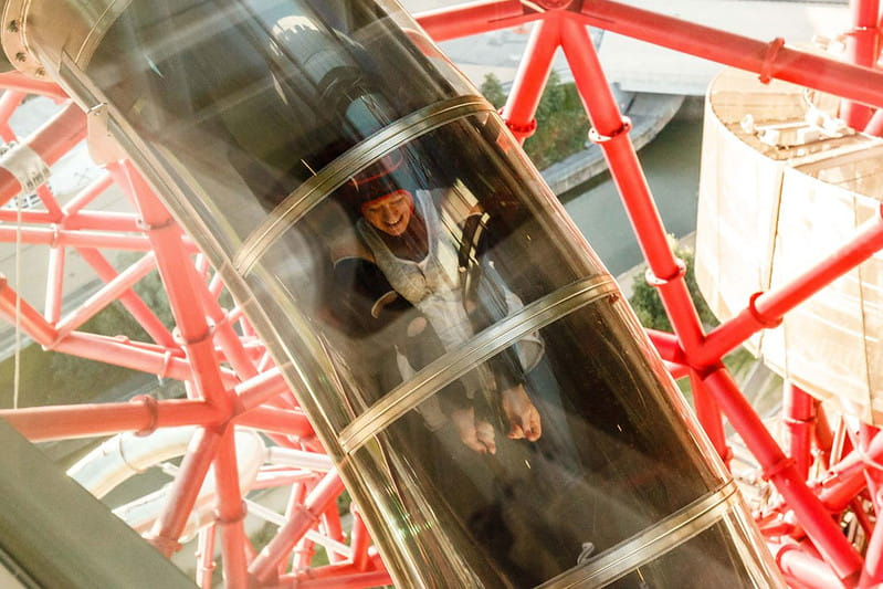 Person riding the ArcelorMittal Orbit slide.