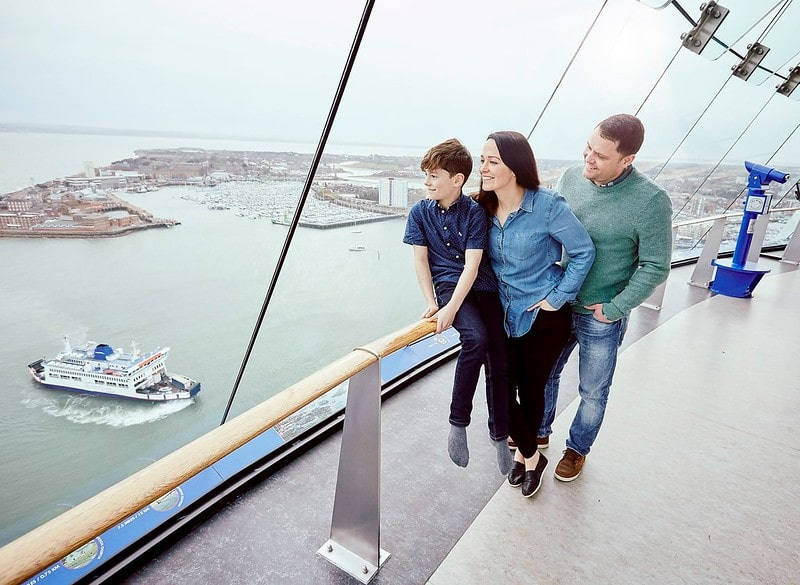 A family enjoy the fantastic views from the Spinnaker Tower in Portsmouth.