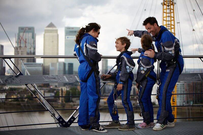 A family looking out at Canary Wharf from on top of the O2.