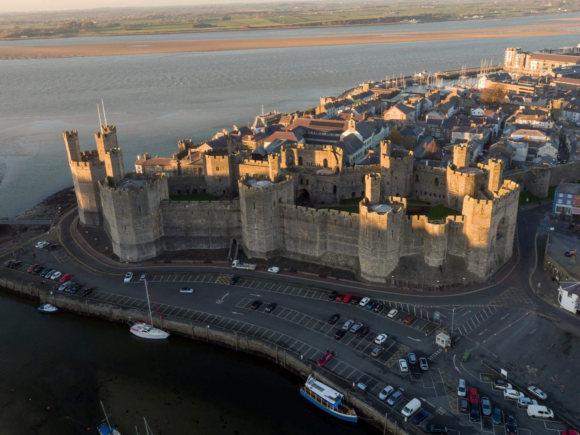 A view of Caernarfon Castle and the river from above.